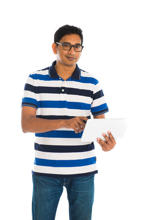 casual indian man with a generic tablet   photo