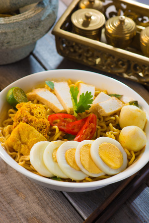 Hot and spicy Singapore Curry Noodle with decoration setup   photo