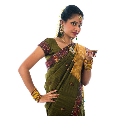 indian style sitting: indian female in traditional clothes with lamp