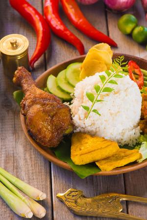 nasi ayam penyet, indonesian fried chicken rice   photo