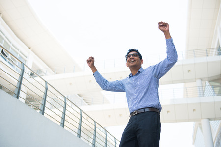 indian business male celebrating success with office  Stock Photo
