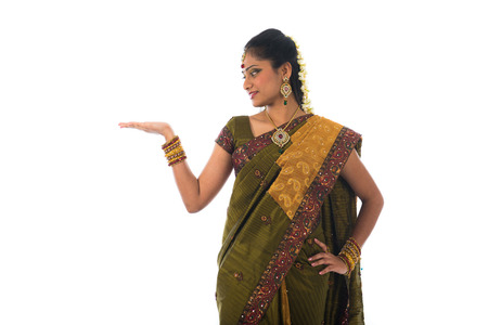 Indian Female wearing sari presenting a product - empty copy space isolated on white    photo