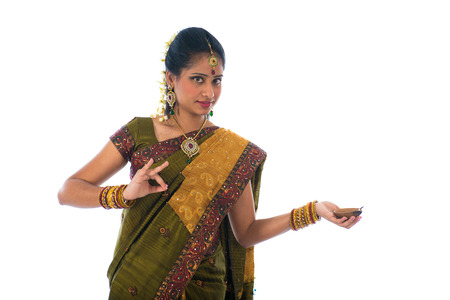indian female in traditional clothes with lamp photo