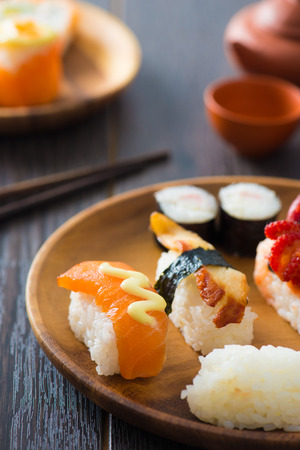 maki: Salmon and caviar rolls served on a plate   Stock Photo