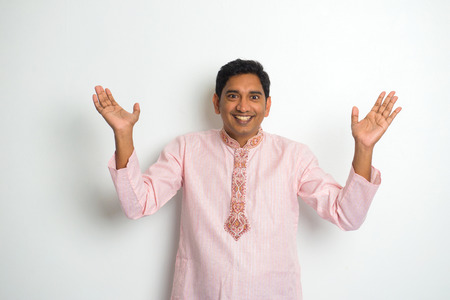 kurta: young indian male in traditional cloths celebrating bhangra Stock Photo