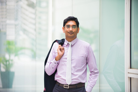 casual indian business male with coat off Zdjęcie Seryjne