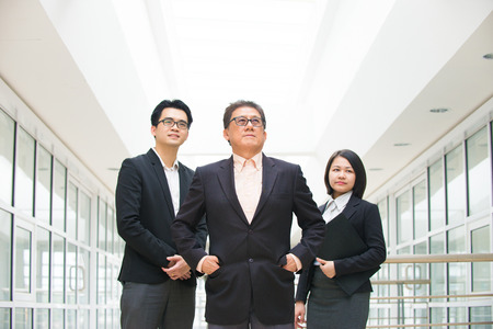 senior business: asian business team in office