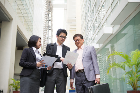 asian business team: asian business team reporting to senior ceo with office