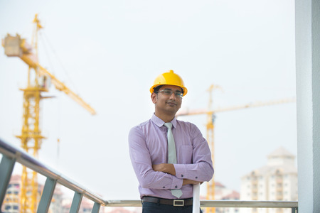 indian male architect  with construction background   photo
