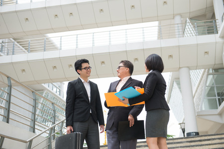 senior business: asian business team reporting to senior ceo with office background