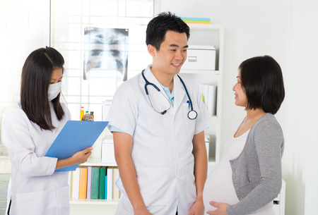 asian doctor: asian pregnancy check up with doctor and mother Stock Photo