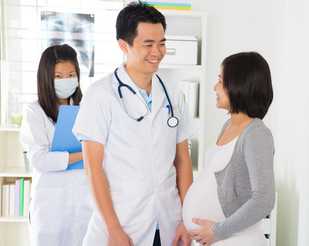 asian pregnancy check up with doctor and mother photo