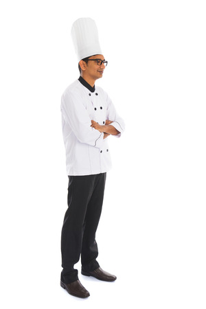 side view indian male chef isolated on white background photo