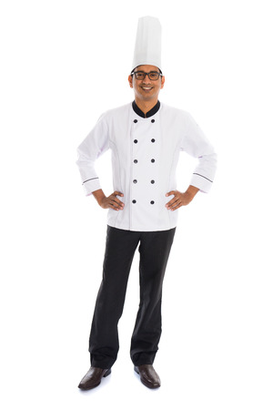 indian male chef isolated on white background photo