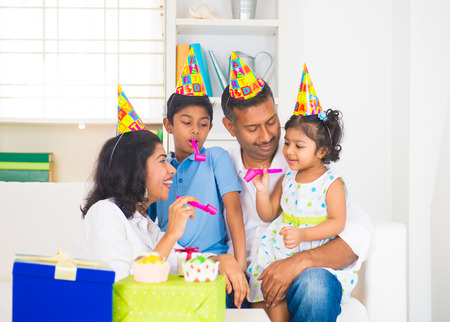 indian family birthday celebration with son and daughter photo