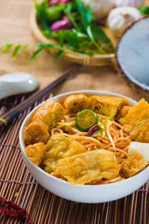 laksa: singapore curry noodles with tradtional setting Stock Photo
