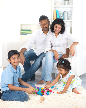 happy indian family enjoying quality time indoor photo