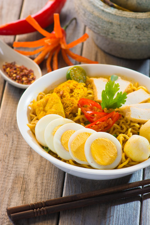 thai noodle soup: thai curry noodles with background Stock Photo