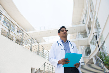 indian male doctor with hospital background photo