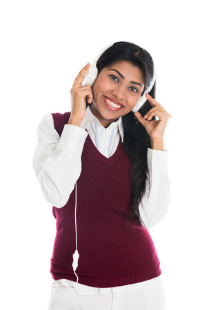 Indian girl dances while listening to her music   photo