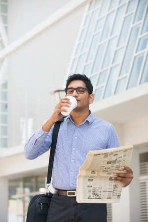 asian indian business man with coffee and papers   photo