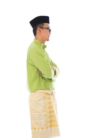 malay male side view with white background photo