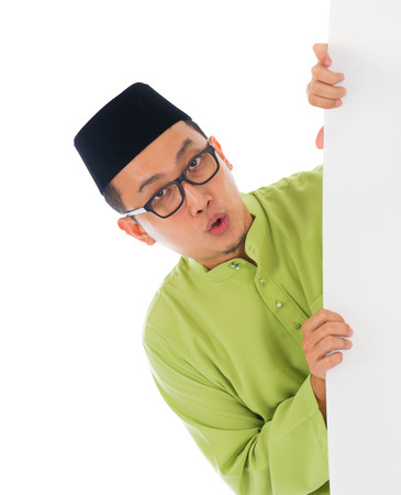 malay male with blank card during hari raya Eid al-Fitr aidilfitri celebration   photo