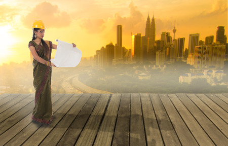 indian saree: traditional indian female engineer with kuala lumpur city background Stock Photo