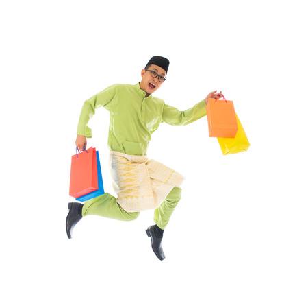 malay male during raya shopping