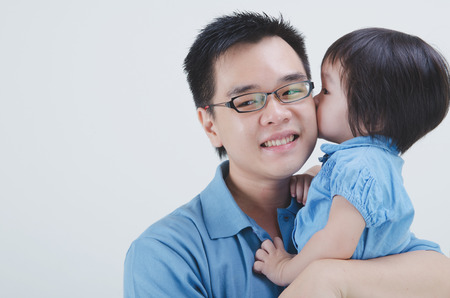 single father: asian father and daughter on plain background