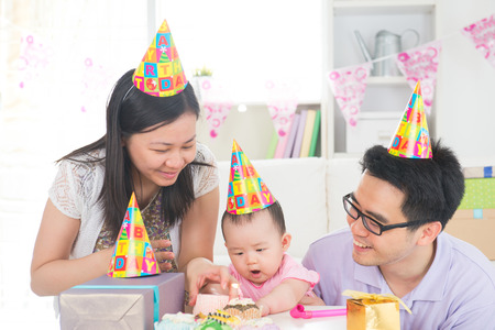 asian baby with family celebrating baby full moon party photo