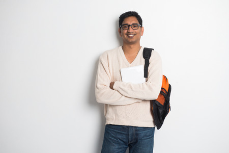 male student: casual indian male student on a sweater and tablet   Stock Photo