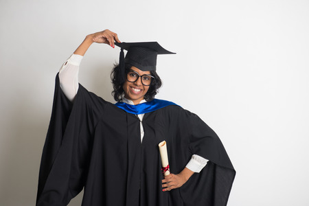 indian female graduate  with grey background photo