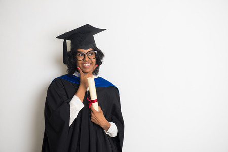 indian female graduate thinking with grey background photo