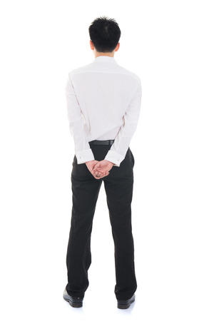 man behind:  Asian business man from the back - looking at something over a white background