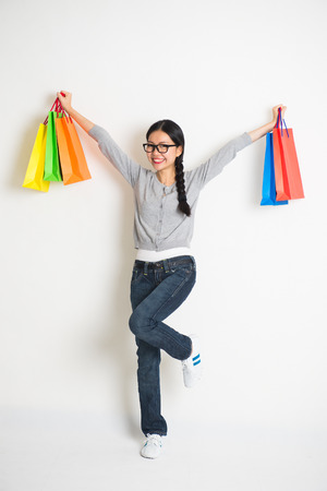 asian shopper: casual asian chinese with christmas gifts on white background