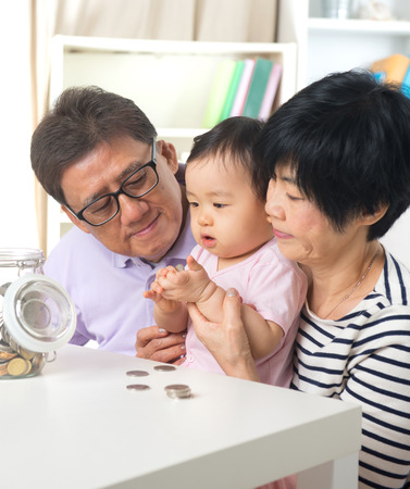 grand parents: asian grand parents with grand daugther education saving concepts Stock Photo