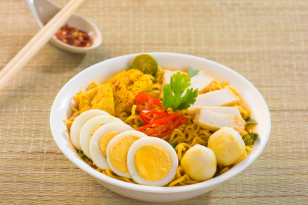 Singapore Curry Noodles with traditional setting photo