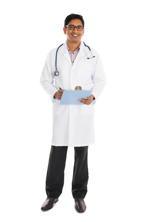 indian male doctor full body writing on board isolated on white photo