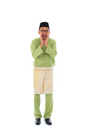 malay male shouting full body photo