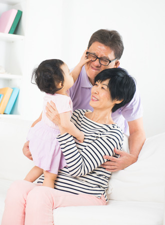 asian grandparents playing with granddaughter lifestyle photo photo