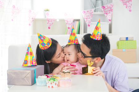 asian baby with family celebrating baby birthday party photo