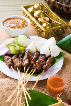 beef satay with traditional background setting