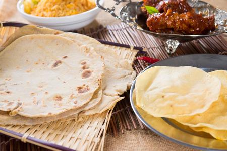 pakistani food: Chapati or Flat bread, roti canai, Indian food, made from wheat flour dough. Roti canai and curry.