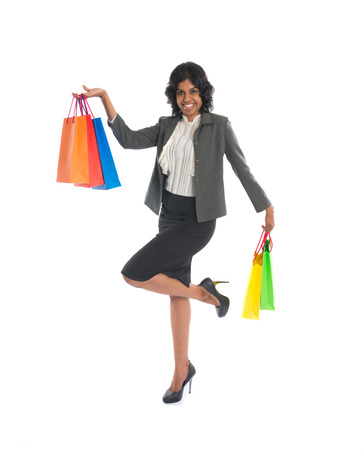 indian woman jumping in joy during shopping spree photo
