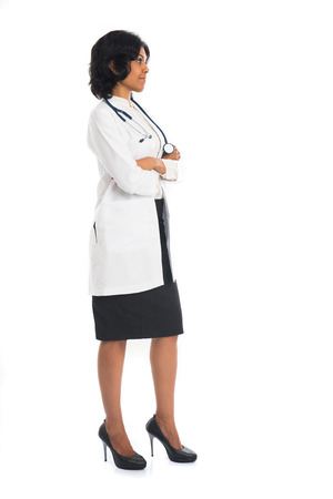 indian female doctor side view full body on white background photo