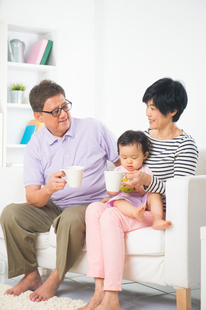 grand father: asian grand parents with grand daugther with life style background