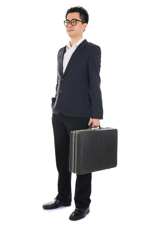 asian businessman with a suitcase isolated on white  photo