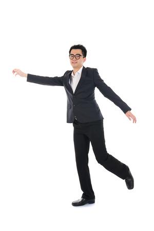 business man running on isolated white background, full length, asian model   photo
