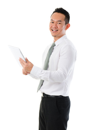 Asian business man using tablet computer isolated on white background photo